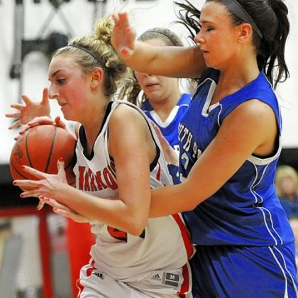 Junior forward Natalie Fekula, getting fouled by South Park's Breanna Raymond during a game last year, averages 10 points per game for Elizabeth Forward.