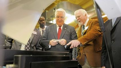 Kent Rockwell, right, chairman and CEO of ExOne, shows Gov. Tom Corbett parts manufactured by ExOne in North Huntingdon.