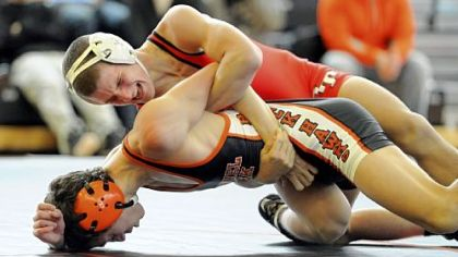 Bethel Park's Michael Vogel, bottom, and Peters Township's Tyler Buckiso wrestle at 126 pounds Wednesday afternoon in at match at Bethel Park.