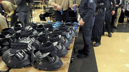 "Officers get their ""sim-guns"" and helmets in the South Fayette cafeteria."