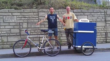Thomas Guentner, 33, of the South Side Slopes and Jeff Newman, 29, of Braddock Hills with their pierogi delivery cart.