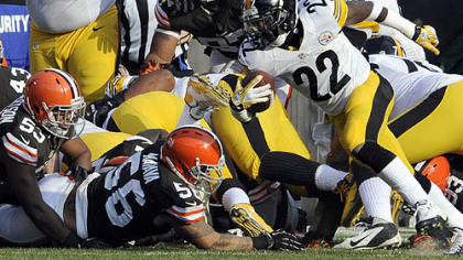 The Steelers' Chris Rainey scrambles for a touchdown at the end of the first quarter in a game at Cleveland in November.
