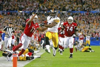 James Harrison scores a touchdown after running back an interception for 100 yards in the second quarter against the Arizona Cardinals during Super Bowl XLIII on February 1, 2009 at Raymond James Stadium in Tampa, Florida.